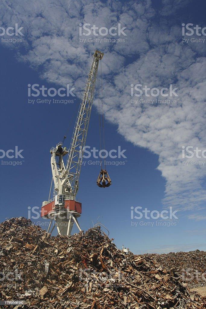Crane and scrap stock photo