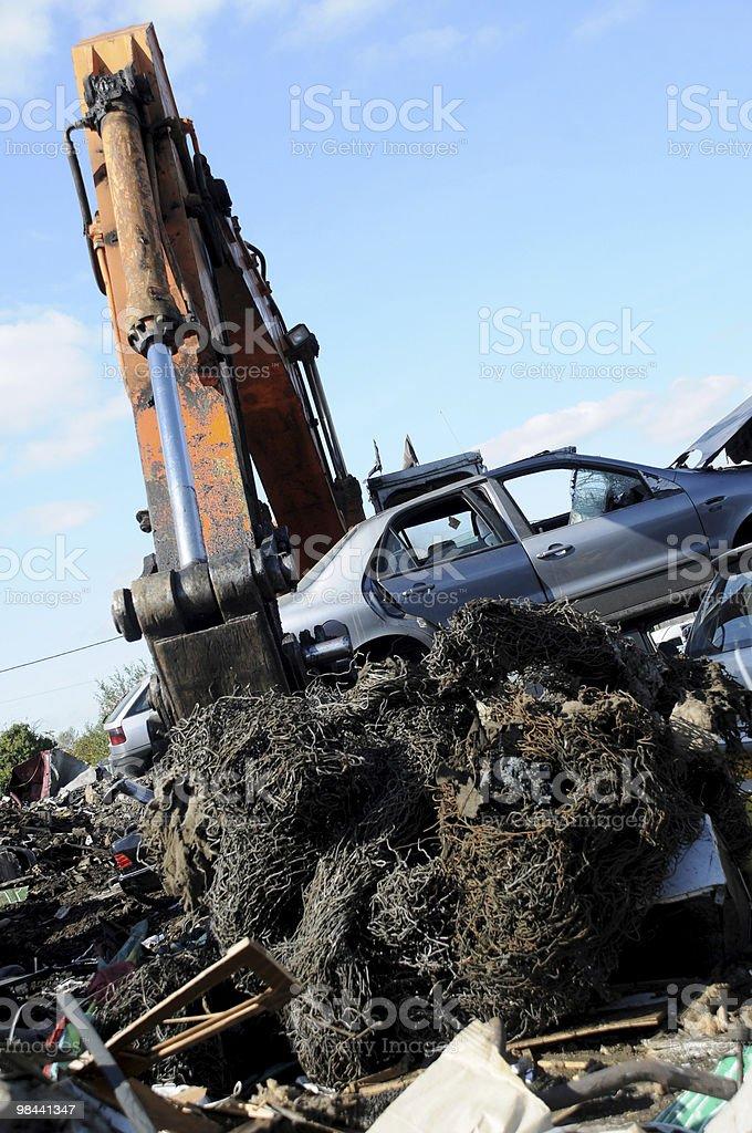 Crane and scrap royalty-free stock photo