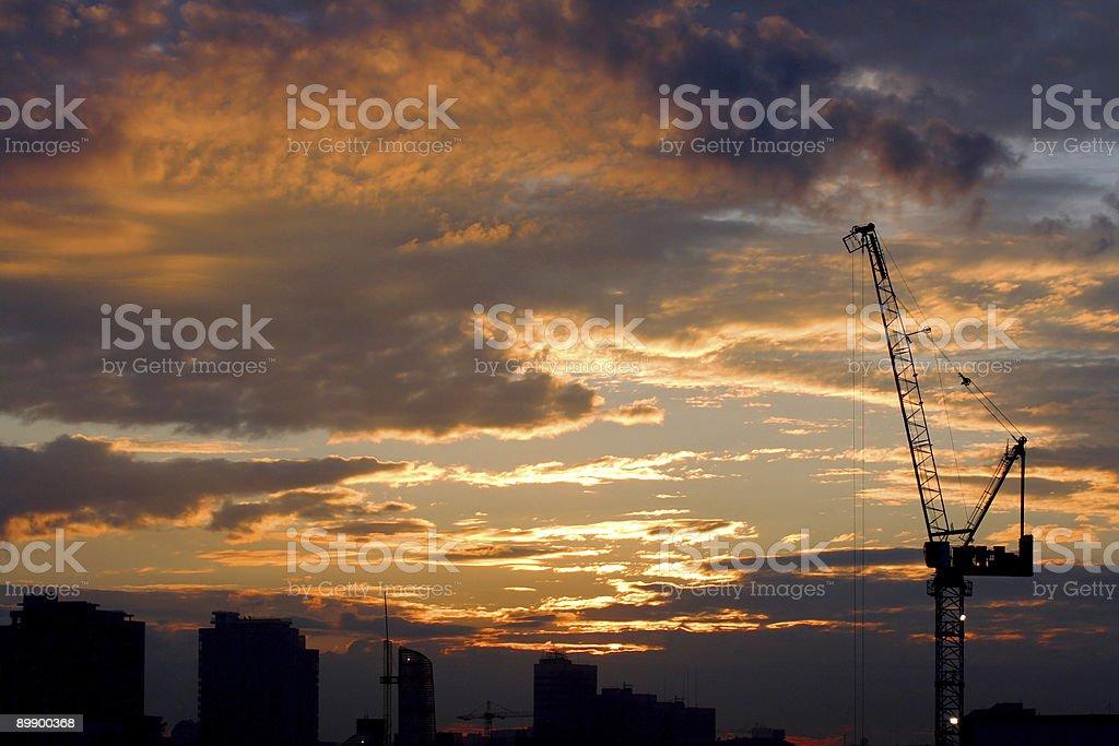Crane and sunrise royalty-free stock photo