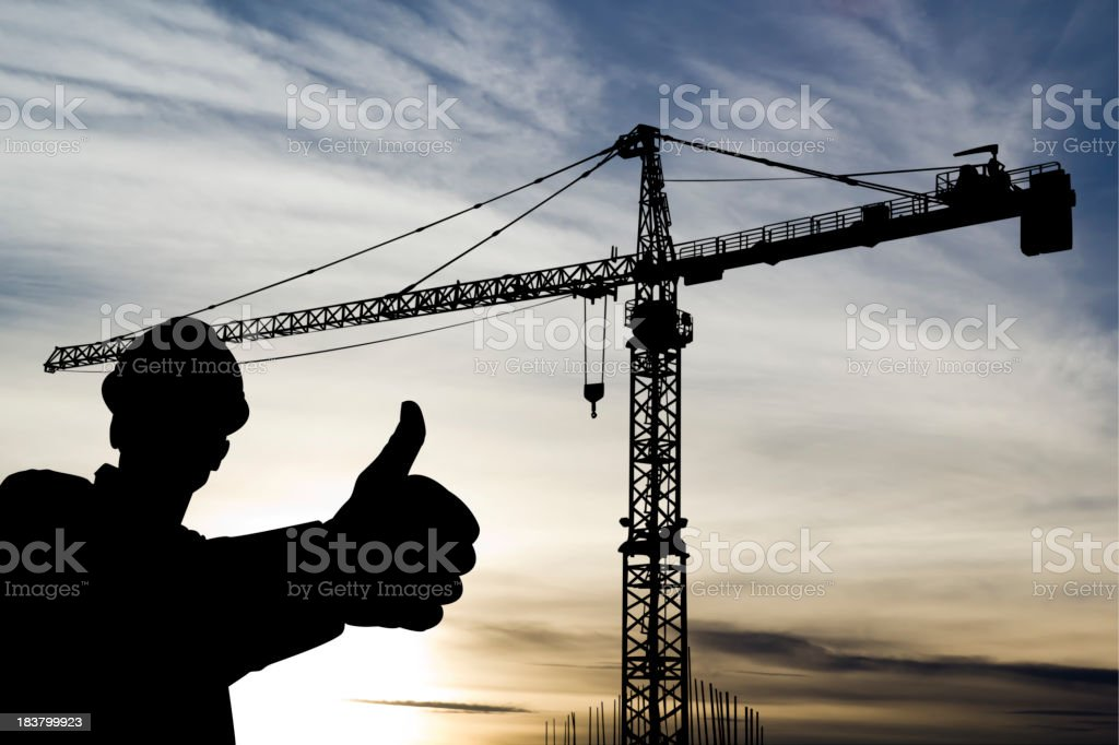 Crane and Worker royalty-free stock photo