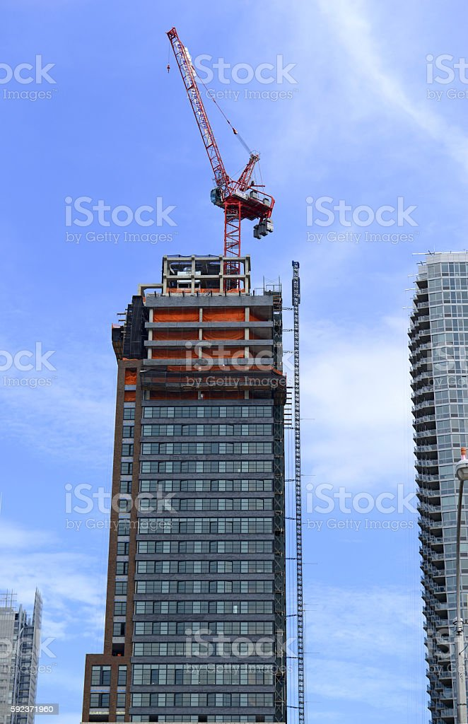 Crane at construction site of new commercial building stock photo