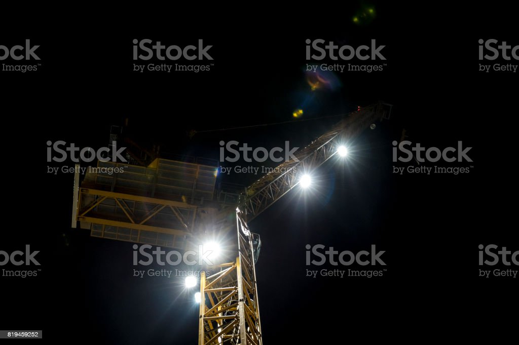 Crane at night with flare stock photo