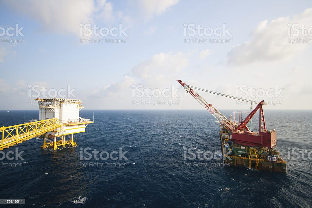 crane barge doing marine heavy lift stock photo