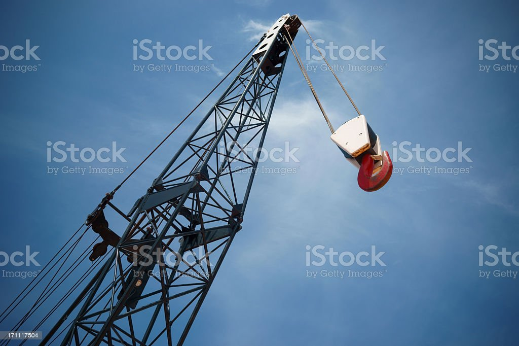 Crane boom and hook with sky background. stock photo