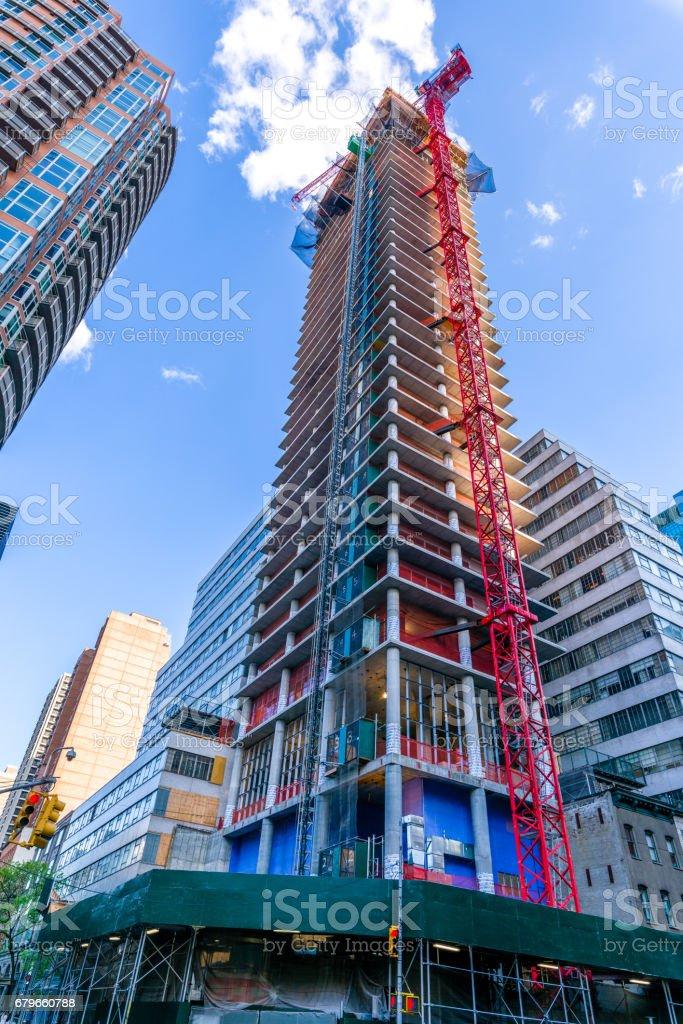 A crane building a skyscraper in New York City stock photo