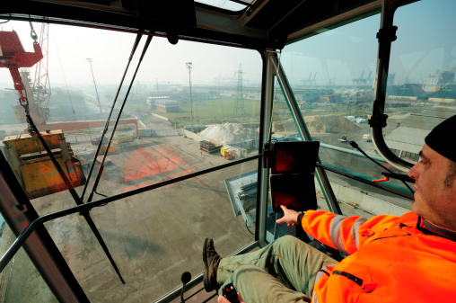 Crane Cabin View And Operator Stock Photo - Download Image Now