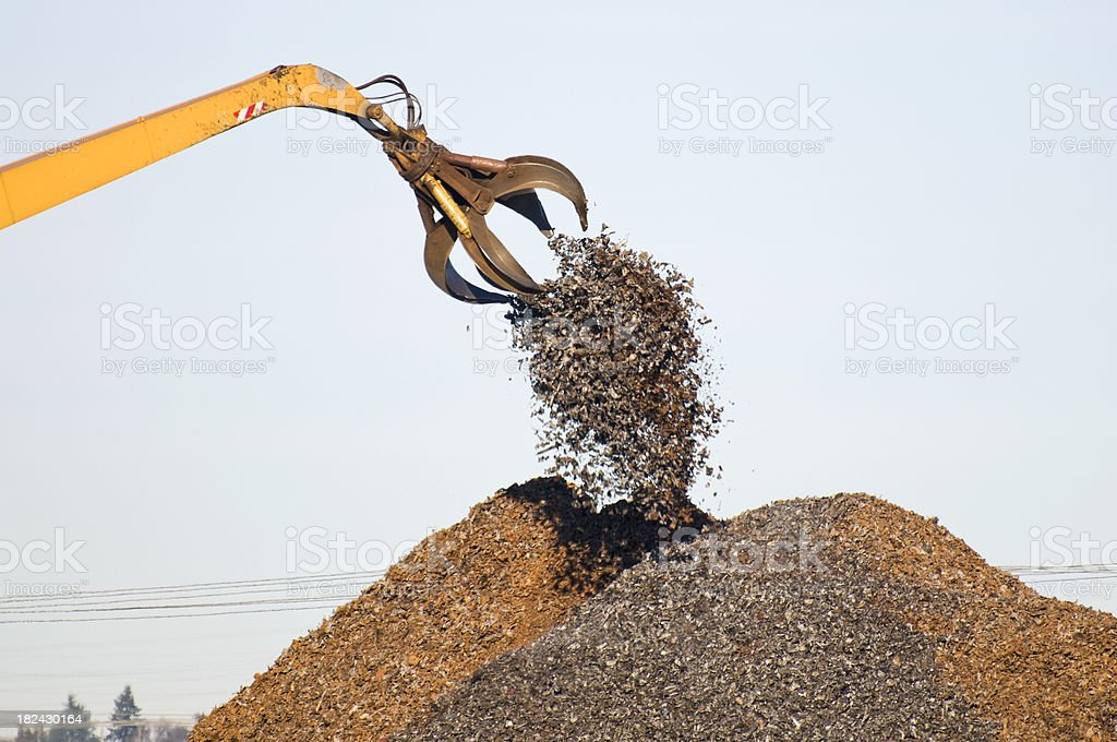 Crane depositing scrap metal on pile royalty-free stock photo