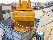 Discharging Wheat from bulk carrier ship with grab