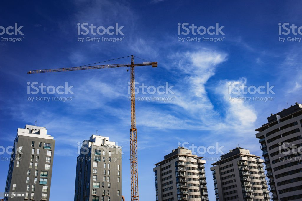 Crane for the construction of a new residential building, real state.