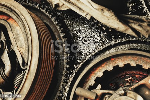 Grease-coated gears of an old shipyard crane.
