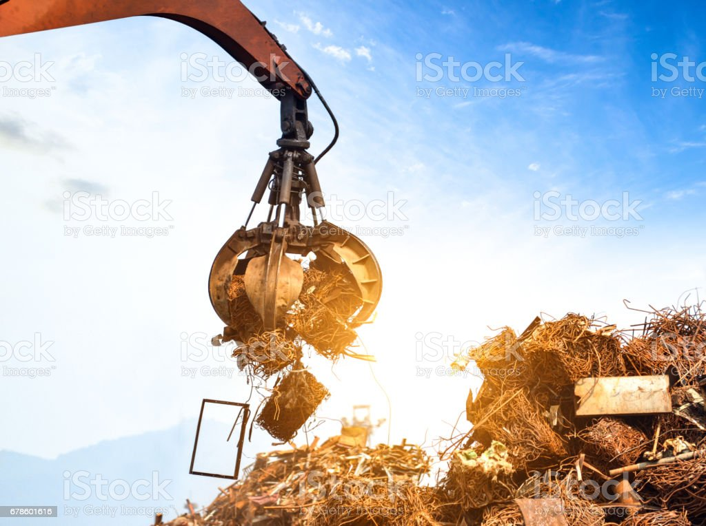 Crane grab scrap stock photo