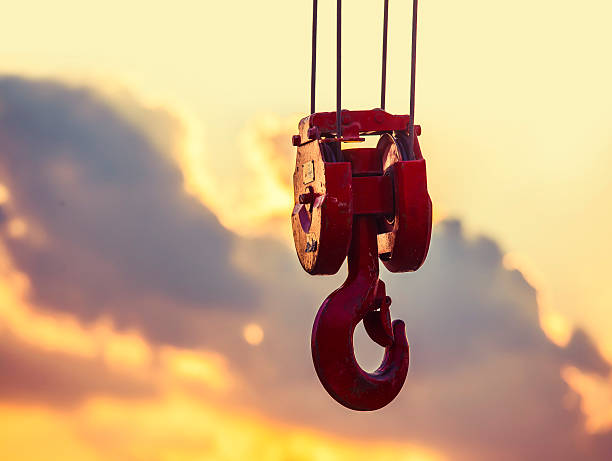 Crane hook crane hook hanging in the air at sunset rigging stock pictures, royalty-free photos & images