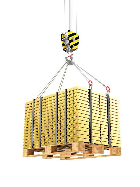 crane hook mit steinkaminen goldenen balken auf einer holzunterlage drapiert - bankhaken stock-fotos und bilder