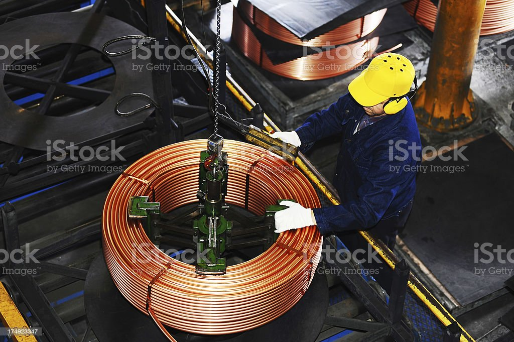 Crane in factory and worker stock photo