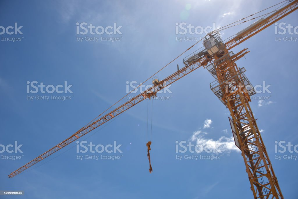 Crane is used in the construction of buildings stock photo