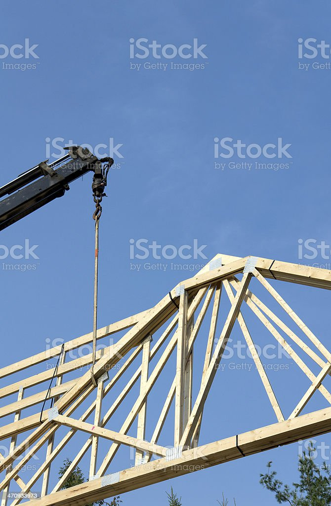 Crane Lifing House Trusses royalty-free stock photo