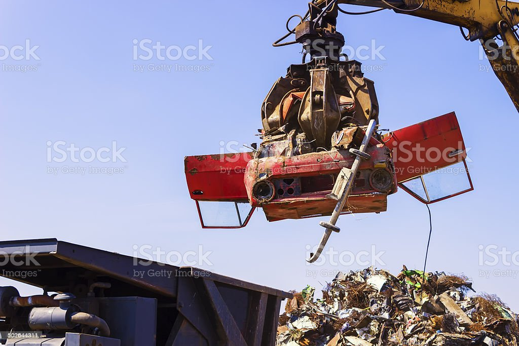 Crane lift old car for recycling. stock photo