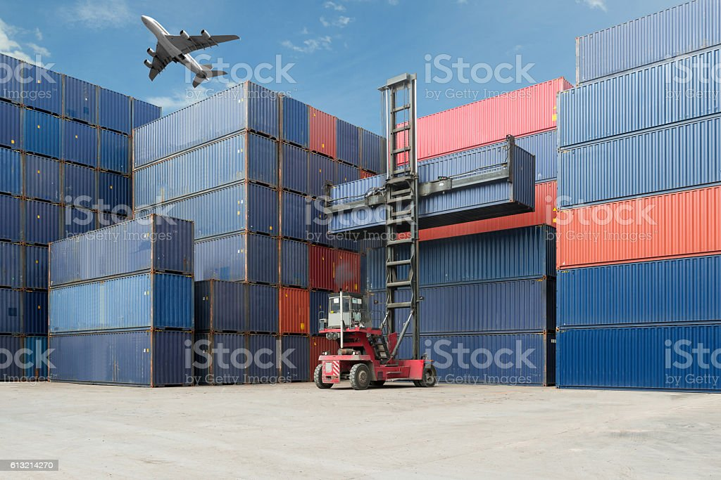 Crane lift up container box loading to cargo container depot stock photo