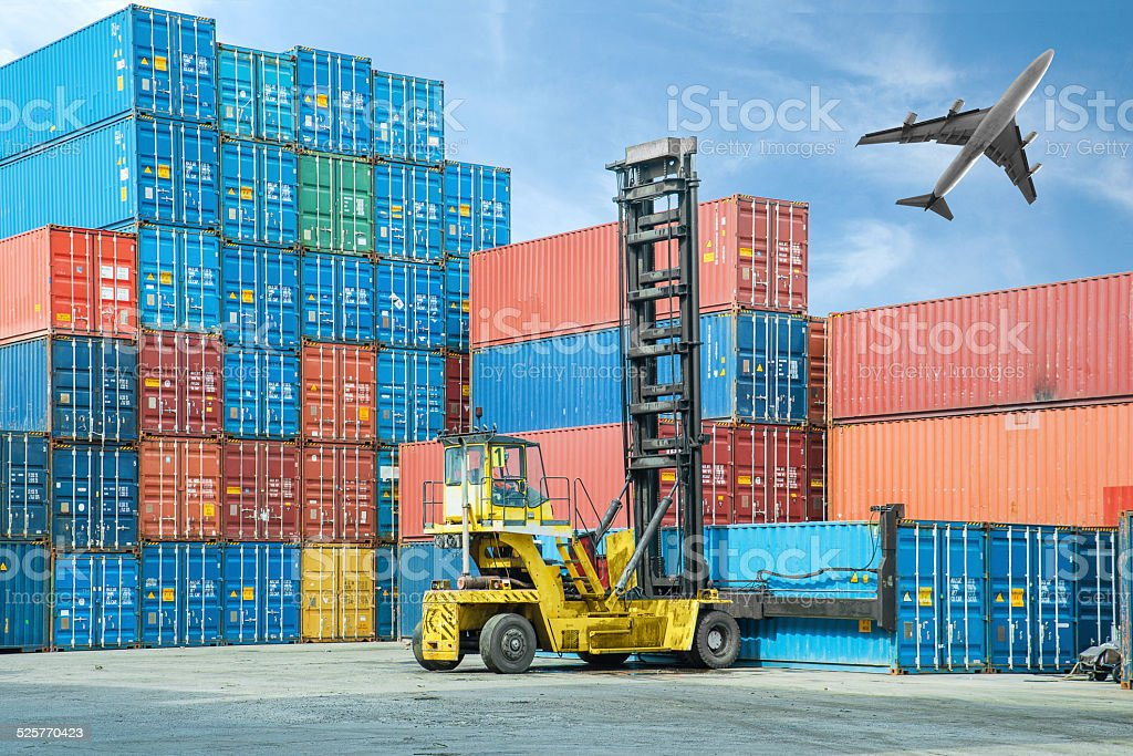 Crane lifter handling container box loading to truck royalty-free stock photo