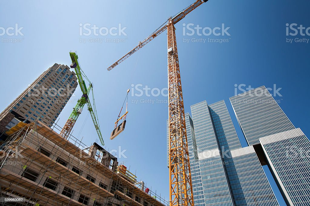 Crane lifting a wall on a construction site​​​ foto