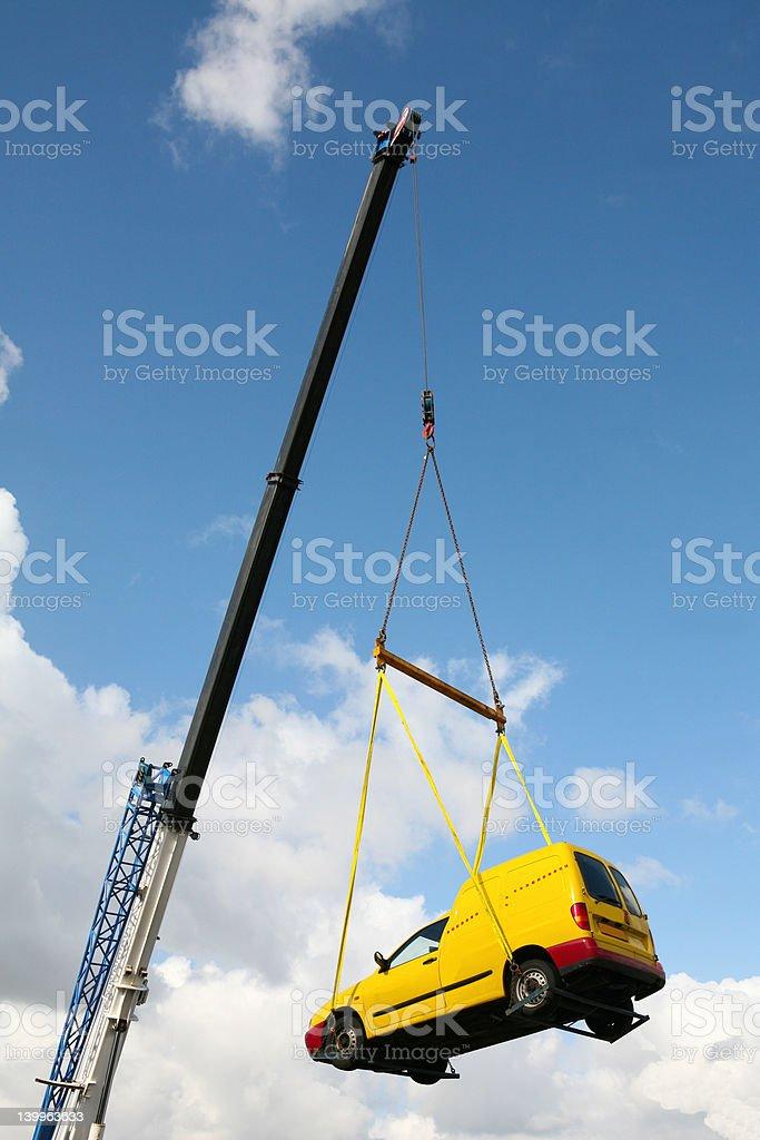 crane lifting car royalty-free stock photo