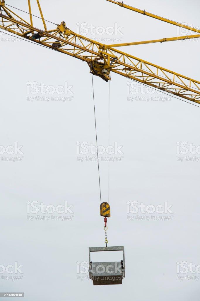 Crane lifting cargo stock photo