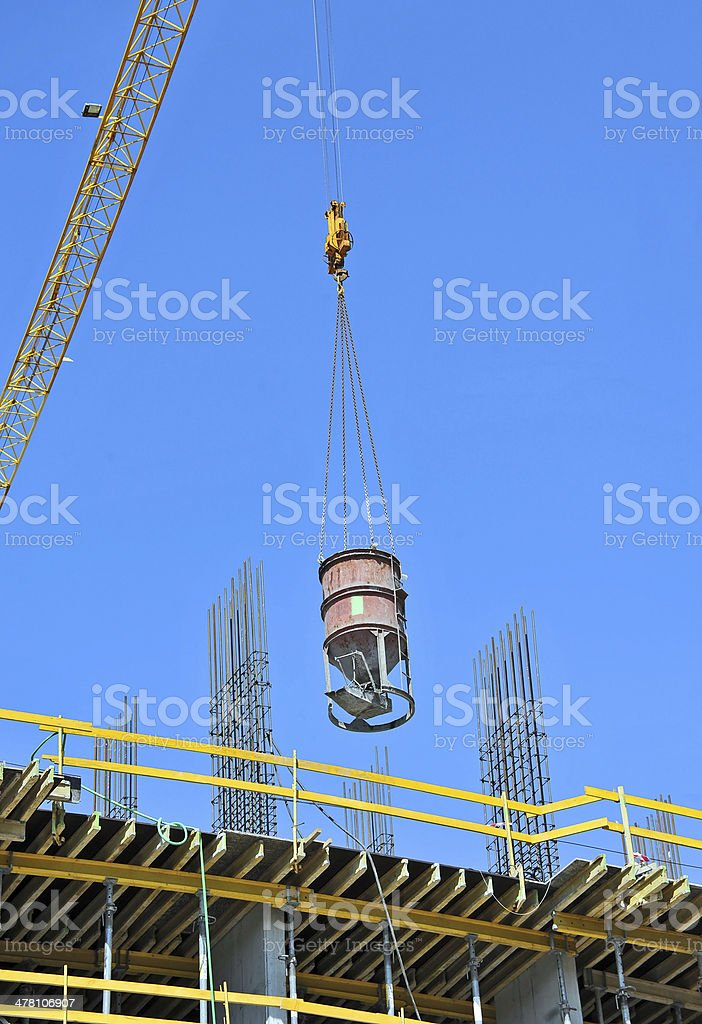Crane lifting cement mixing container royalty-free stock photo