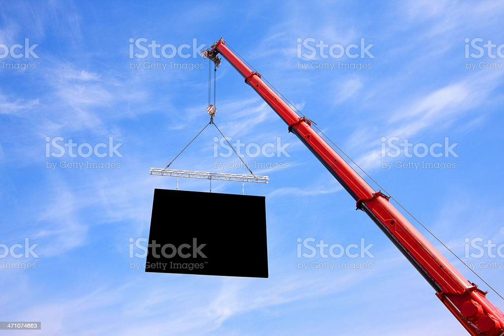 Crane lifting Flat Panel into Sky stock photo