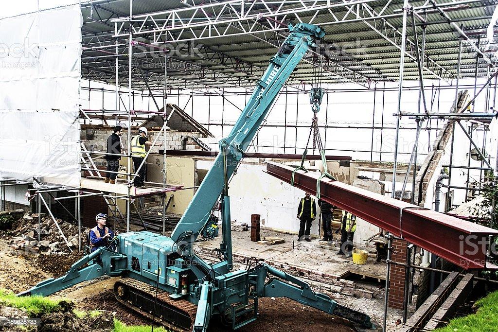 Crane lifting steel beam stock photo