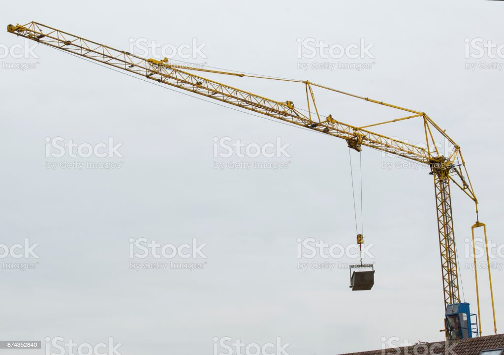 crane lifting steel cargo box stock photo