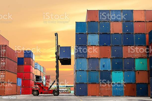 Crane Lifting Up Container In Yard Stock Photo - Download Image Now
