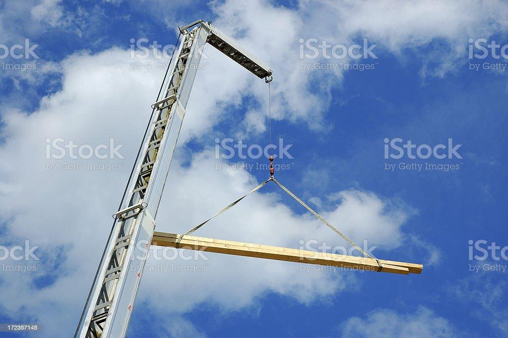 Crane lifting wood royalty-free stock photo