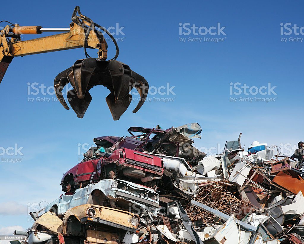 Crane loader taking scrap iron stock photo
