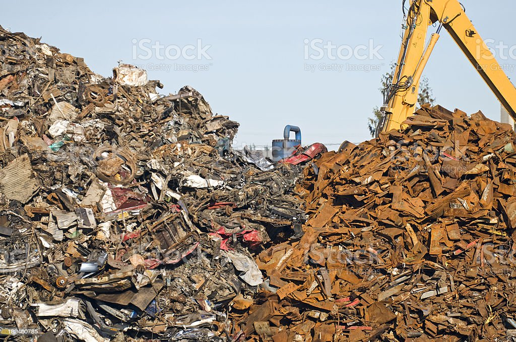 Crane moving scrap metal at recycling plant royalty-free stock photo