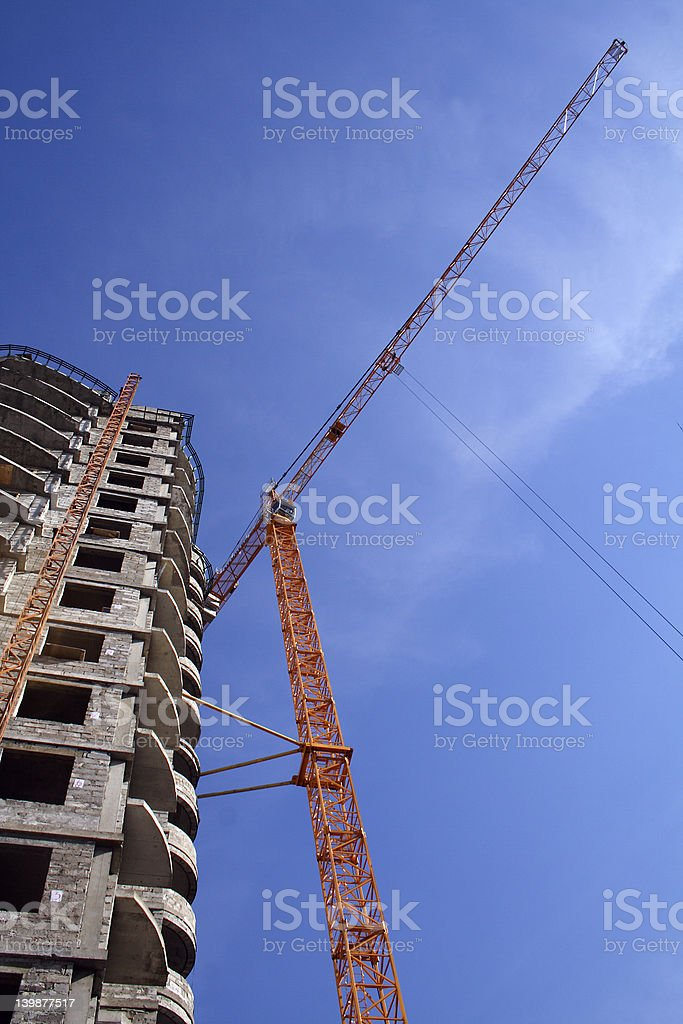 crane on construction of building royalty-free stock photo