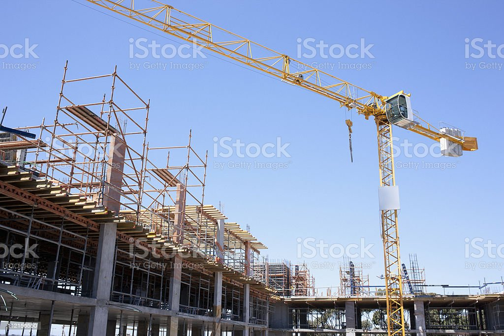 Crane on construction site stock photo