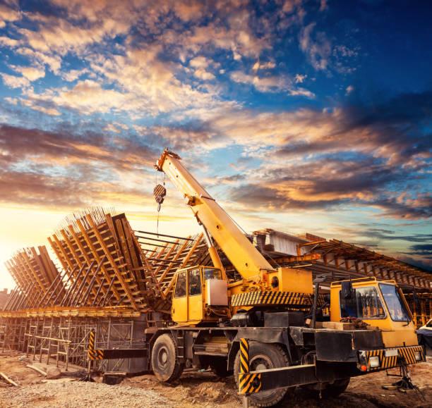 Crane on the viaduct construction site stock photo