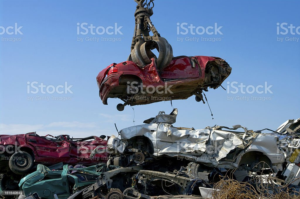 Crane picking up car stock photo