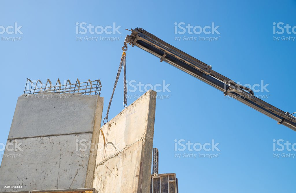 Crane removing encasement stock photo