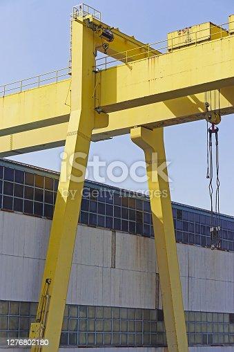 Big yellow gantry crane in shipyard industry