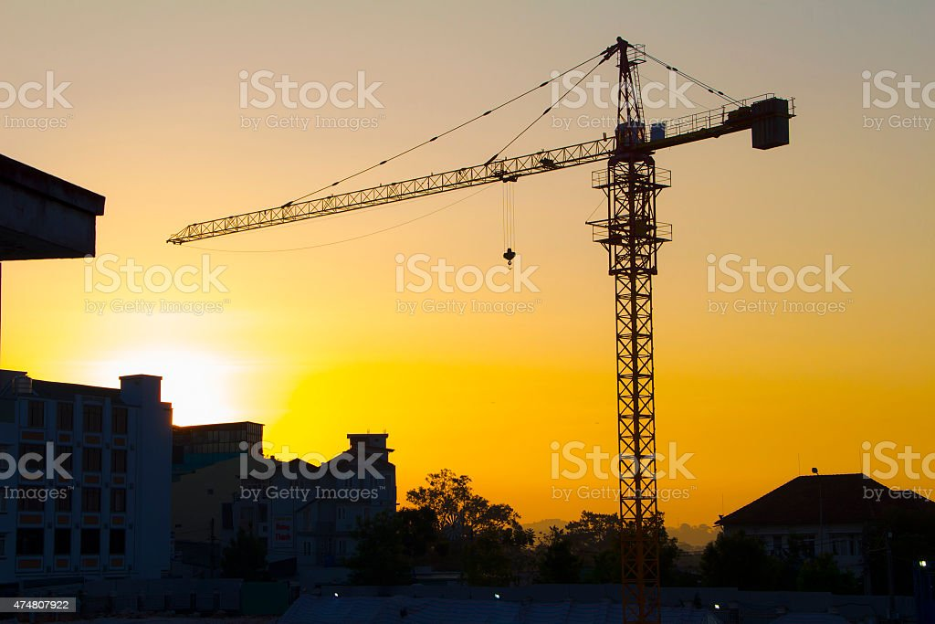 crane silhouette twilight stock photo