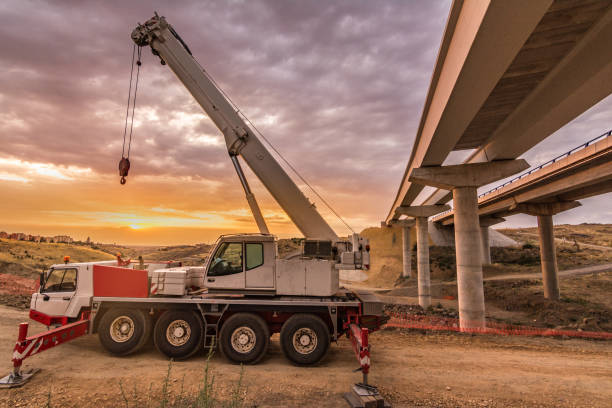 Crane truck on a building site Big truck with a mobile crane mobile crane stock pictures, royalty-free photos & images