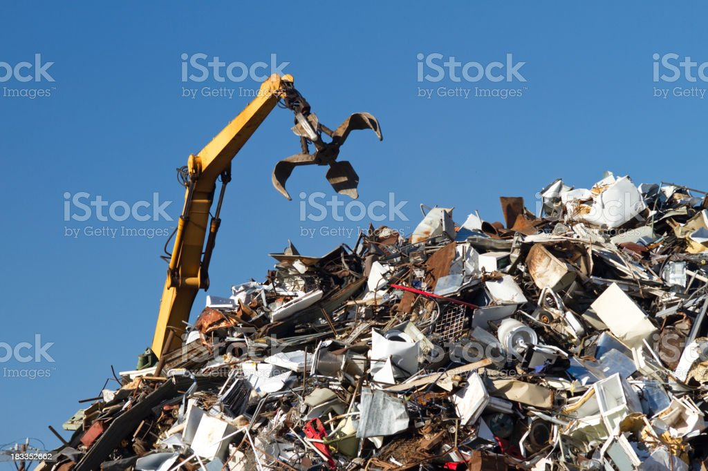 Crane With Open Claw, Metal Recycling Junkyard, Blue Sky stock photo