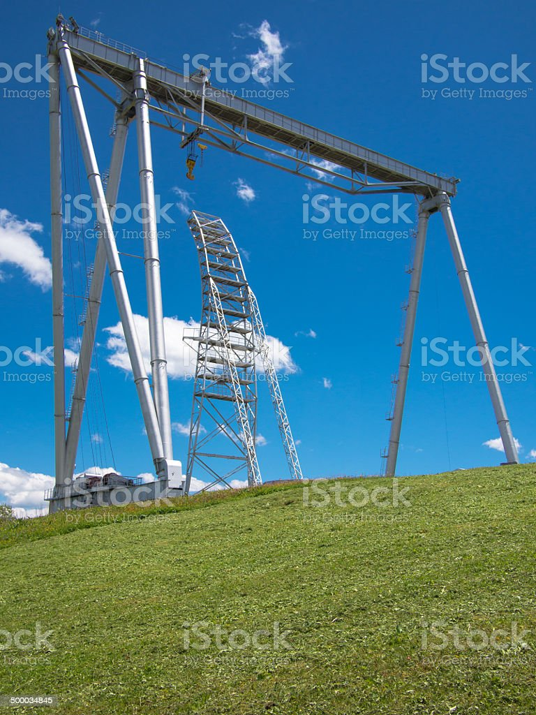 Crane with stairs on a hill stock photo