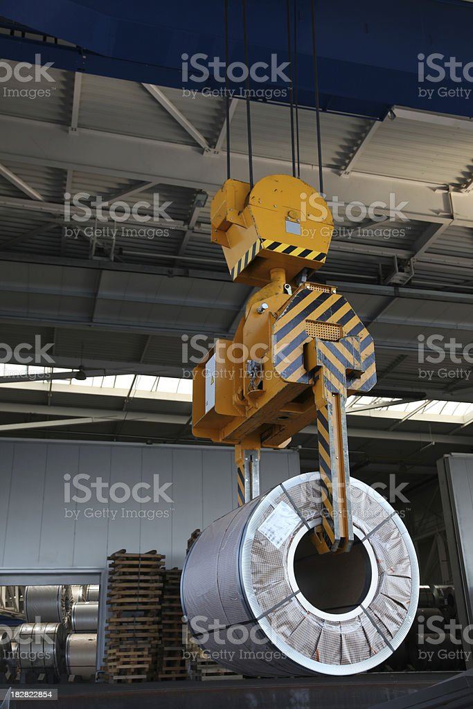 Crane with steel coil stock photo