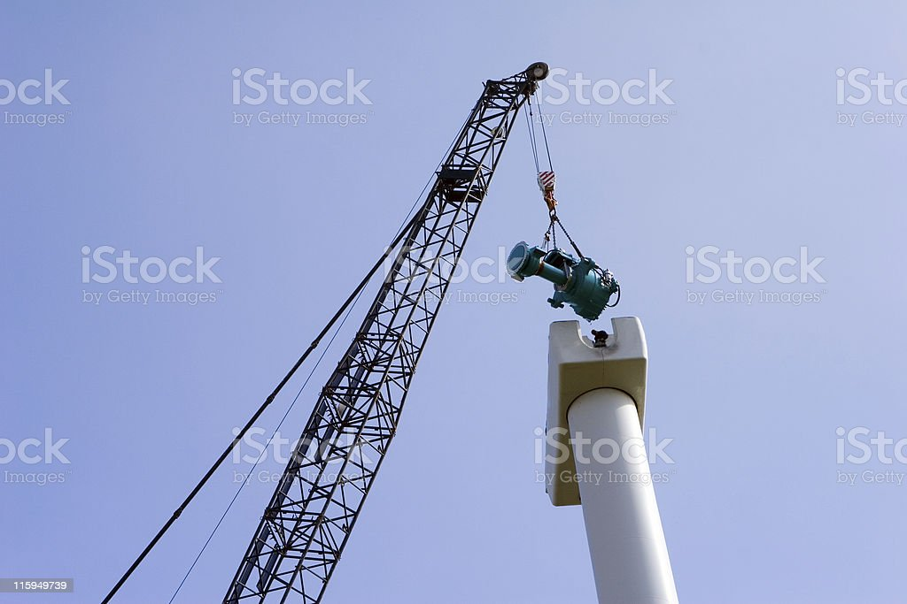 Crane with the gear of an wind turbine royalty-free stock photo