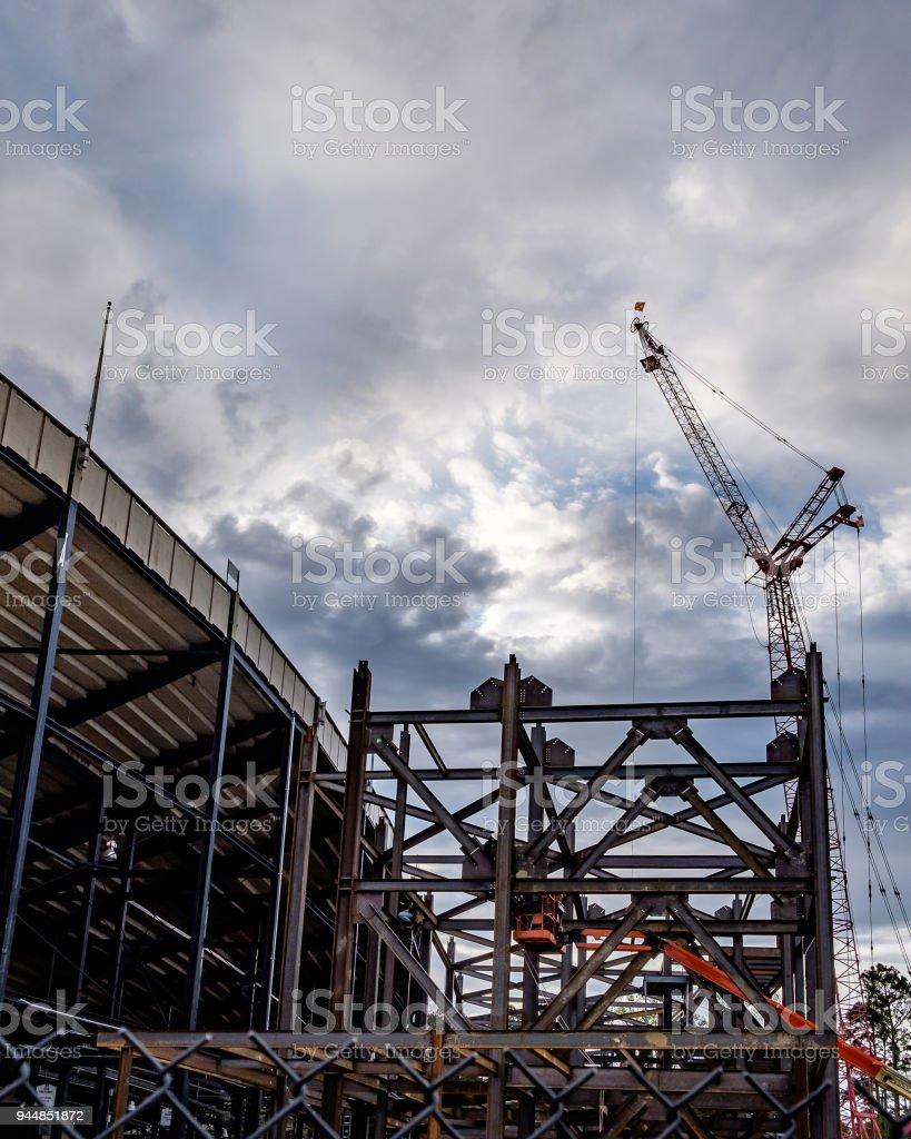 Crane Working at Sunrise stock photo