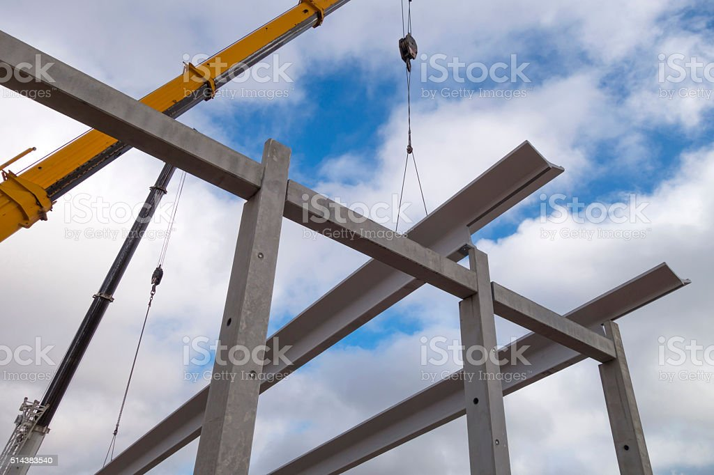 Crane working in the construction site stock photo