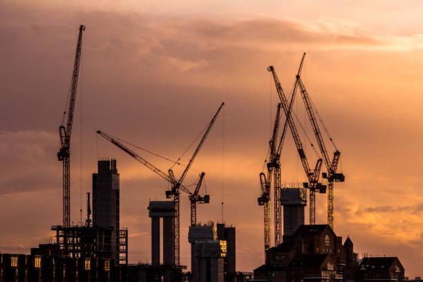 Cranes and construction equipment on London city skyline stock photo
