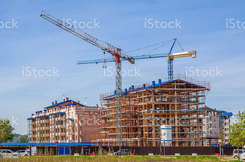 Cranes and new modern buildings. stock photo